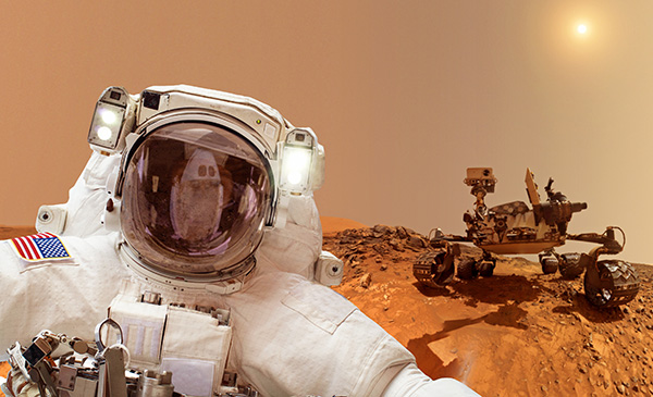 astronaut with mars rover