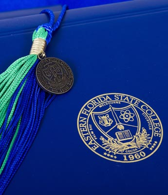 honors graduate blue and green tassle over cap