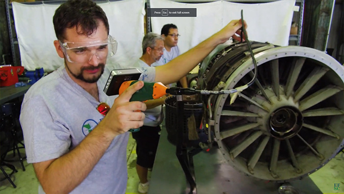Aviation male student with aircraft engine