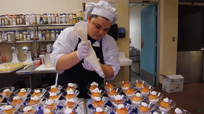 Female culinary student making pastries