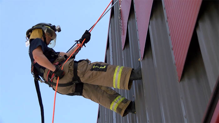 Fire Fighter Repelling Down Building
