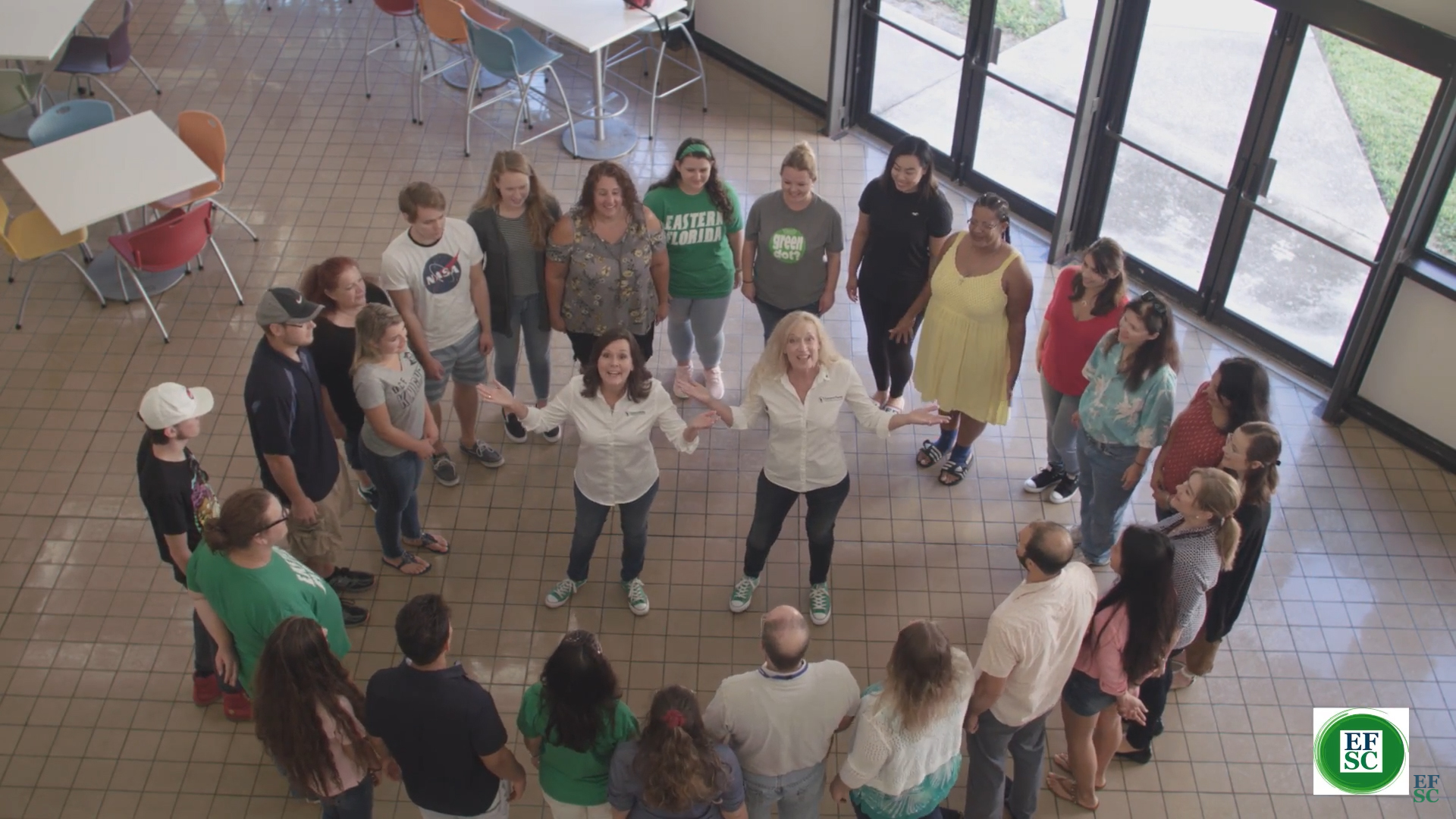 faculty, staff and students in a circle as part of Green dot lip sync challenge