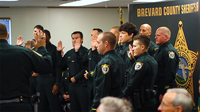 police officer students being sworn in