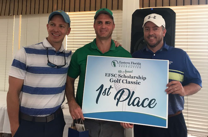 three golfers with first place sign