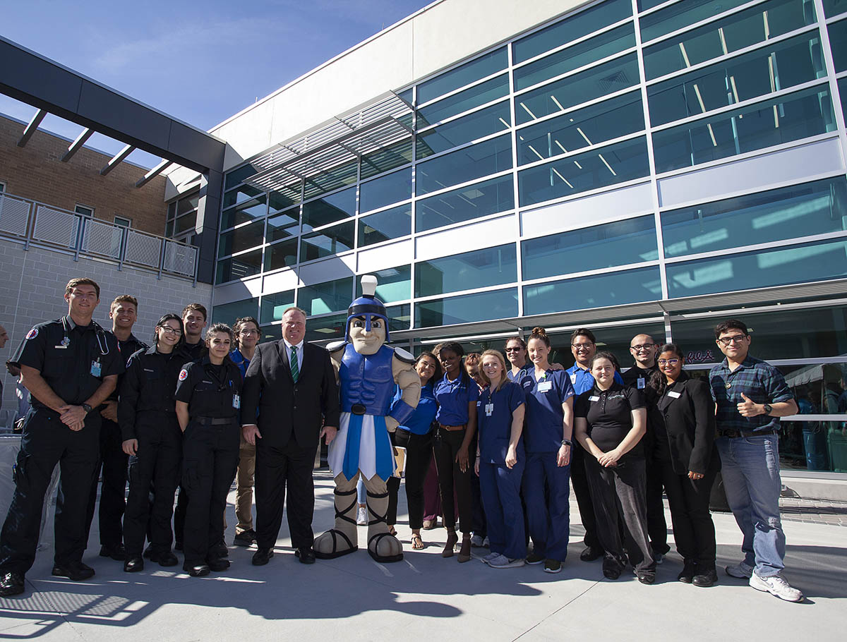 Large glass Student Union building with students and Dr. James Richey, EFSC President