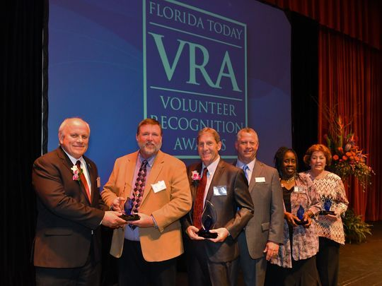 award winners under Florida Today VRA sign