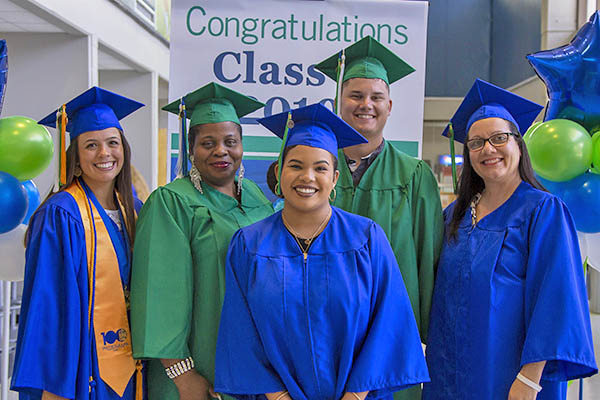 EFSC graduates in blue and green caps and gowns
