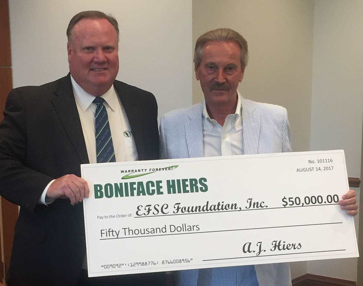 Dr. Jim Richey accept donation from AJ Hiers