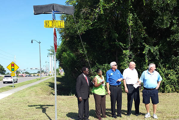 Dr. Joe Lee Smith unveiling sign