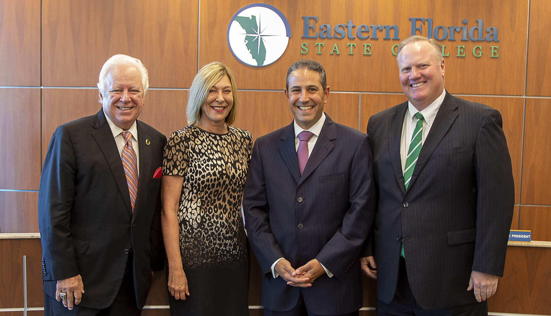 Three men and one women at EFSC Board of Trustees meeting