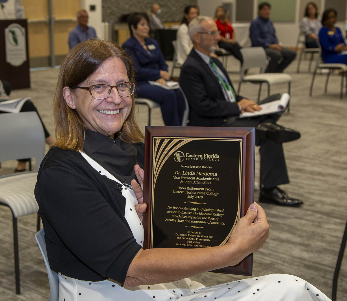 Dr. Linda Miedema with retirement plaque