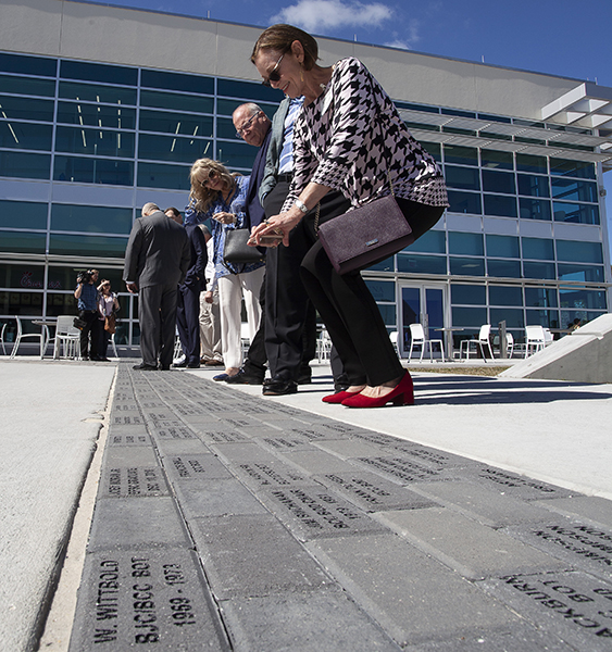 people looking at engraved pavers at EFSC Student Union