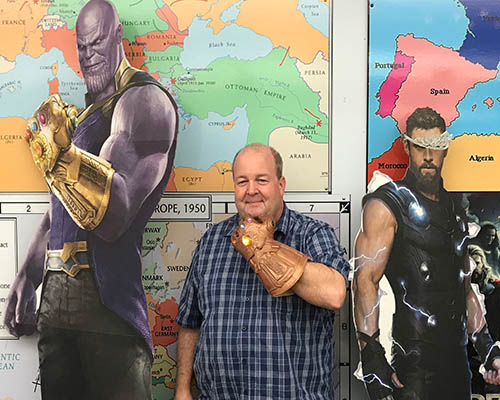 Thanos life-size cut out, instructor Luke Leonard with Thanos glove and avengers character