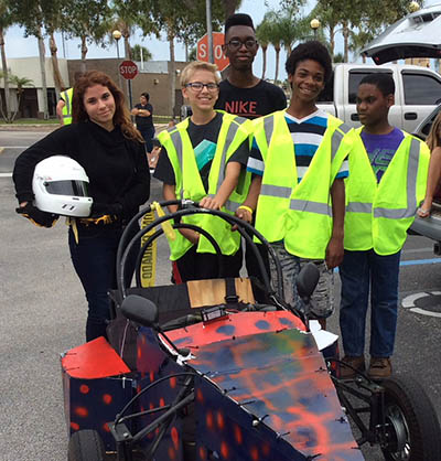 STEM Tech student with car